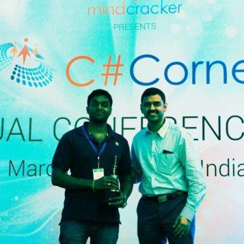 Receiving C# Corner MVP Award from SQL master Vinod Kumar M